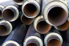 堆金属用管道输送有加热器和pvc壳的管 图库摄影