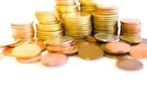 堆金黄和铜币 免版税库存图片