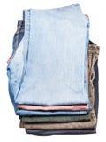 堆顶视图各种各样的牛仔裤和条绒 库存照片