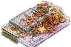 堆首饰和货币 免版税库存图片