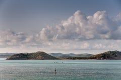 堡礁的海岛在cloudscape,澳大利亚下的 库存图片