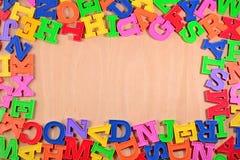 塑料五颜六色的字母表信件框架  免版税库存图片