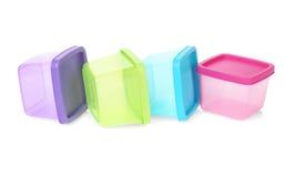 塑料五颜六色的容器 免版税库存照片