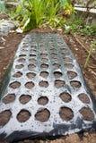 黑塑料农业腐土板料 免版税库存图片