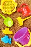 塑料孩子为使用戏弄在sandpit或在海滩 库存照片