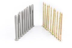 塑料定缝销钉或墙上插头别针有螺丝的砖的 库存照片