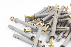 塑料定缝销钉或墙上插头别针有螺丝的砖的 免版税库存图片