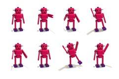 塑料机器人女孩用不同的姿势 图库摄影