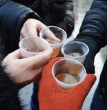塑料杯子用香槟 免版税库存照片