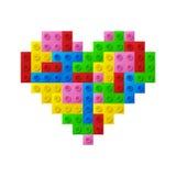 从塑料玩具块的心脏。 免版税库存照片