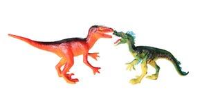 塑料玩具恐龙战斗场面 免版税库存照片