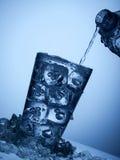 塑料瓶和一块玻璃与冰 库存照片