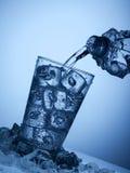 塑料瓶和一块玻璃与冰 免版税库存照片