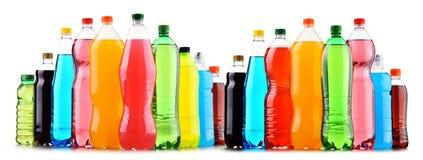 塑料瓶在白色的被分类的碳酸化合的软饮料 免版税图库摄影