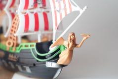从塑料的式样海盗船,在灰色背景, 免版税库存图片