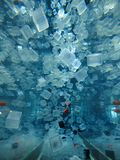 Plastic cubes in water 图库摄影