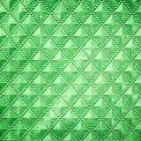 塑料纹理样式是backg的一个对角线色的正方形 图库摄影