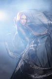 塑造一名新红头发人妇女的射击礼服的 库存图片