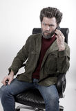 塑造一件被编织的毛线衣和夹克的人 免版税库存图片