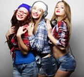 塑造三个时髦的性感的行家女孩最好的朋友画象  免版税库存照片