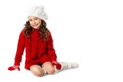 塑造冬天被编织的衣裳的小女孩在被隔绝的白色背景 免版税图库摄影