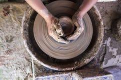 塑造在横式转盘的儿童手碗 图库摄影