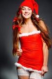 塑造女孩辅助工圣诞老人 免版税库存图片
