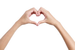 塑造心脏标志后部的妇女的手, 免版税图库摄影