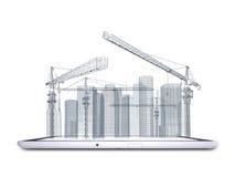 塔吊和摩天大楼片剂个人计算机的 免版税库存图片