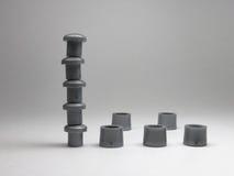 塔,被建造立场腿和盖帽圆盘的 免版税库存照片
