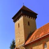 塔 被加强的中世纪教会在村庄Malancrav,特兰西瓦尼亚 库存图片