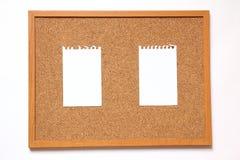 塞住有纸笔记的委员会关于白色背景 免版税库存照片