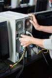 塞住计算机的资深妇女在教室 免版税库存照片