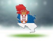 塞尔维亚设计地图与足球场草纹理的  免版税库存照片