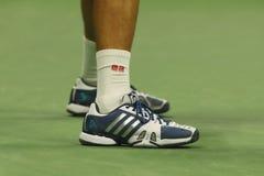 塞尔维亚的全垒打冠军诺瓦克・乔科维奇穿习惯爱迪达网球鞋在决赛期间在美国公开赛2016年 库存图片