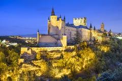 塞戈维亚,西班牙城堡在晚上 免版税库存照片