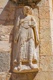 塞戈维亚,西班牙, 2016年4月- 14日:传道者安心古代罗马教会Iglesia de圣米格尔火山门面的  免版税库存照片