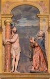 塞戈维亚,西班牙, 2016年4月- 14日:被雕刻的多彩雕刻的小组Flagallated耶稣和圣皮特圣徒・彼得在大教堂里 免版税库存照片