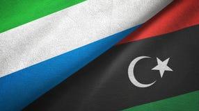 塞拉利昂和利比亚两旗子纺织品布料,织品纹理 免版税图库摄影