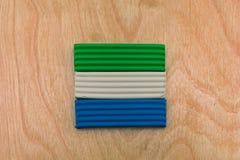 塞拉利昂的旗子从彩色塑泥的 库存照片