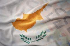 塞浦路斯的五颜六色的挥动的国旗欧元金钱钞票背景的 免版税库存图片