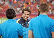 巴塞罗那的Francesc法布雷加斯微笑给他的队友 免版税库存照片