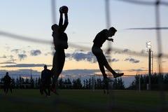 足球运动员剪影  免版税库存照片