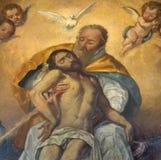 塞维利亚-三位一体细节从油漆灵魂的在教会Iglesia de圣罗克里 免版税库存照片