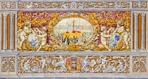 塞维利亚-与发怒场面的队伍作为铺磁砖的'省凹室的'一部分沿广场de西班牙的墙壁 库存图片