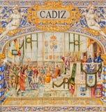 塞维利亚-作为其中一间的卡迪士铺磁砖的'省凹室'沿广场de西班牙的墙壁 免版税库存图片