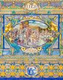塞维利亚-作为其中一间的卢戈铺磁砖的'省凹室'沿广场de西班牙的墙壁 库存照片