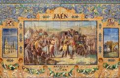 塞维利亚-作为其中一间的吉恩铺磁砖的'省凹室'沿广场de西班牙的墙壁 免版税图库摄影