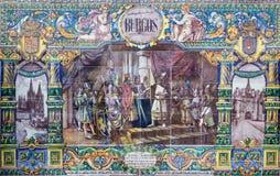 塞维利亚-作为其中一间的布尔戈斯铺磁砖的'省凹室'沿广场de西班牙的墙壁 免版税库存图片