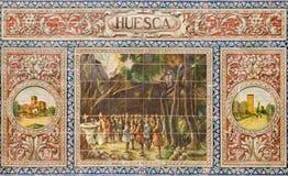 塞维利亚-作为其中一间的韦斯卡省铺磁砖的'省凹室'沿广场de西班牙的墙壁 免版税库存照片